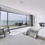 Residential Interior Design Photography of bedroom overlooking sea.